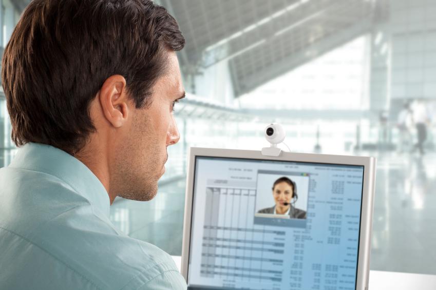 business man having a conversation via webcam.